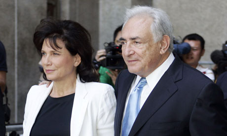 DSK leaving court with his long-suffering/supportive wife