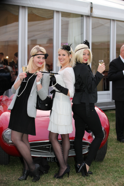 Everybody turned on the 1920s glamour before posing with the vintage cars