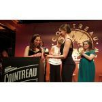 Laetitia Casta gives the Cointreau Grant Scheme Award to Juliet Remembered's team